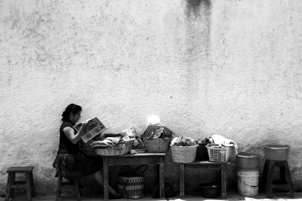 LAdy reading paper