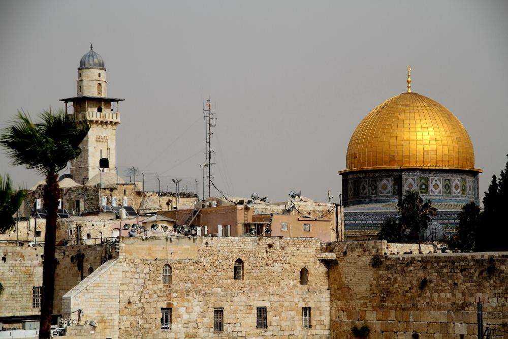 western wall and gold dome mosque